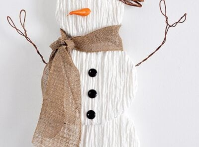 Charming DIY Yarn Snowman Door Hanger