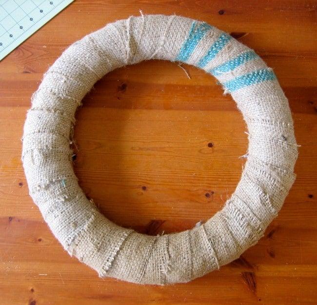 Wrap Straw wreath with burlap