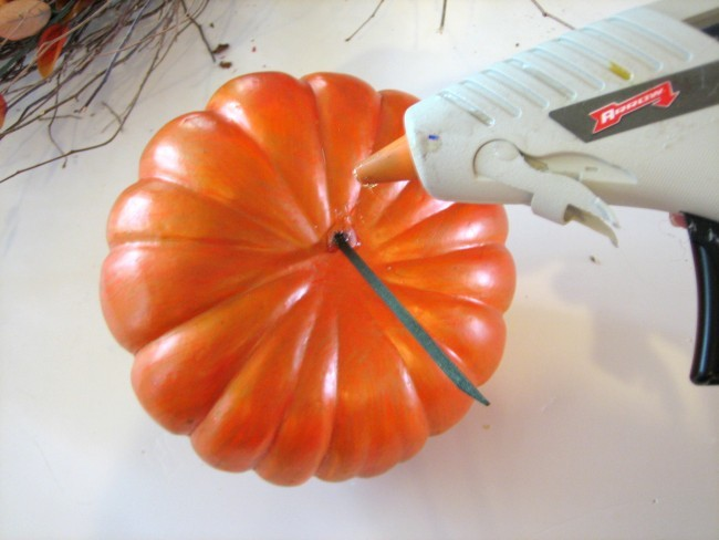 Glue Pick into Pumpkin for an Arrrangement madeinday.com