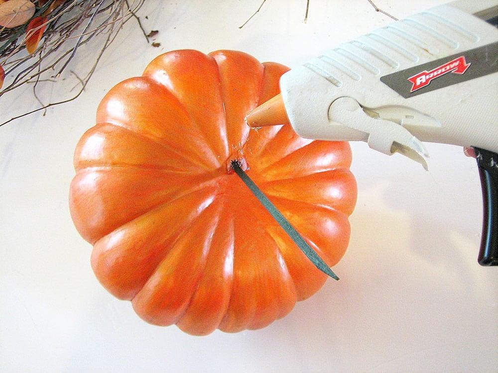 Glue Pick into Pumpkin for an Arrangement