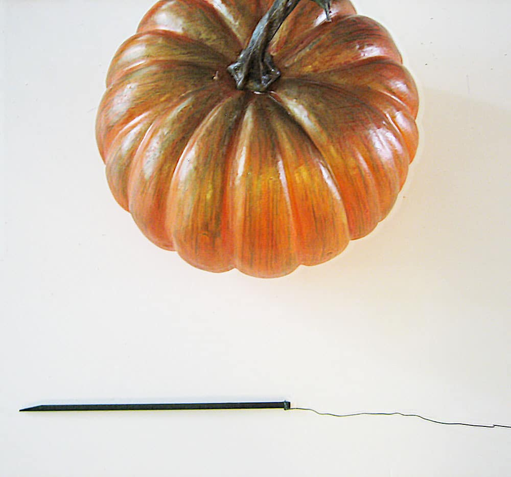 Add a Pick to a Pumpkin to Place in Arrangement
