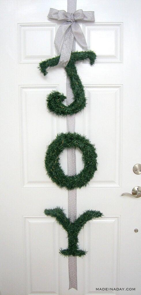 Joy greenery letters door hanger