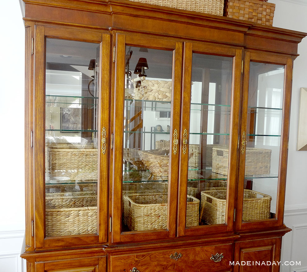 place baskets in china cabinet
