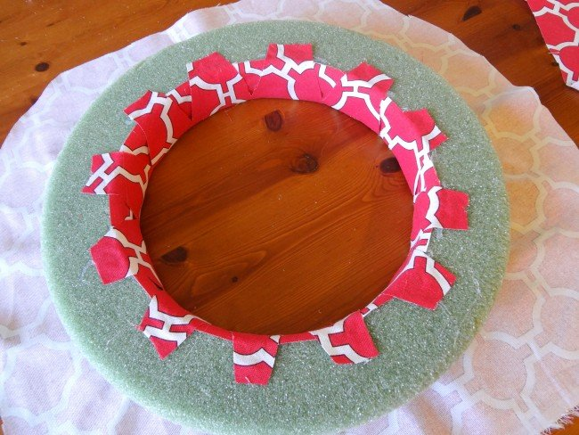 Cut slits in fab and glue to inside wreath