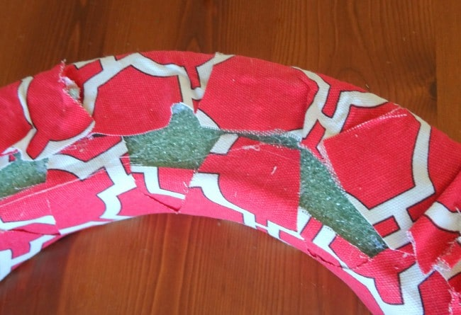 Glue fabric together on back of wreath