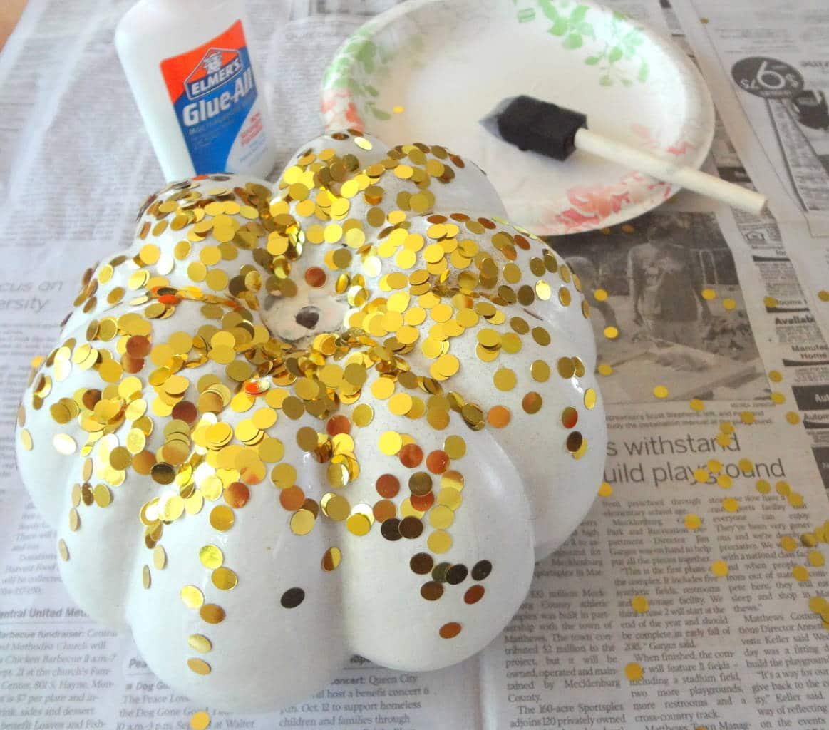 Add Glue to Pumpkin and Sprinkle with Confetti madeinaday.com