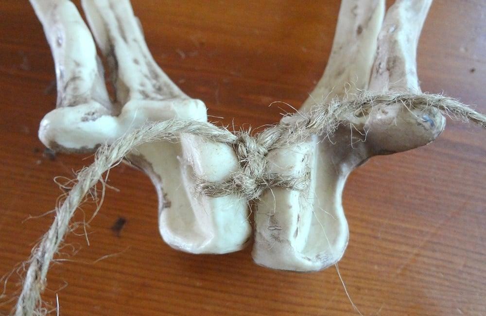 Tie skeleton bones for wreath hanger