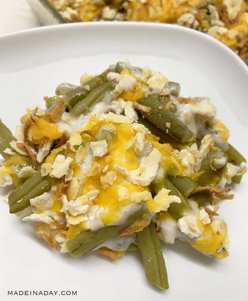 layered green bean casserole, cheese and bean casserole, cheesy baked green beans, saltine cracker green bean casserole