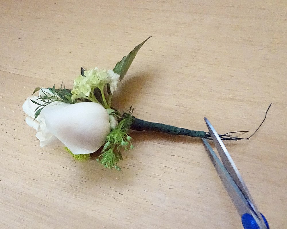 Trim wire ends on boutonniere,