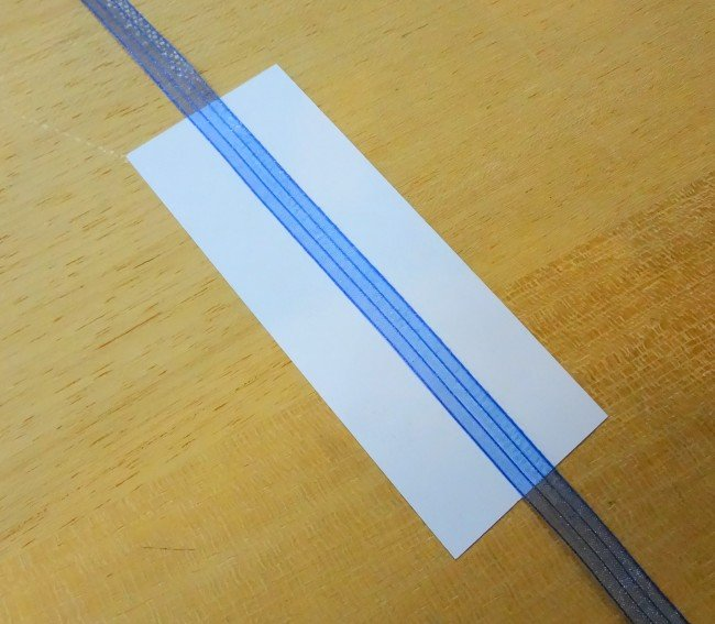 Glue ribbon to card