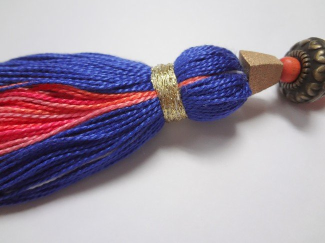 Wrap metallic floss on tassel