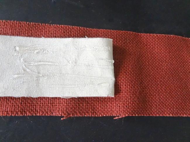 Hot glue ribbon over burlap