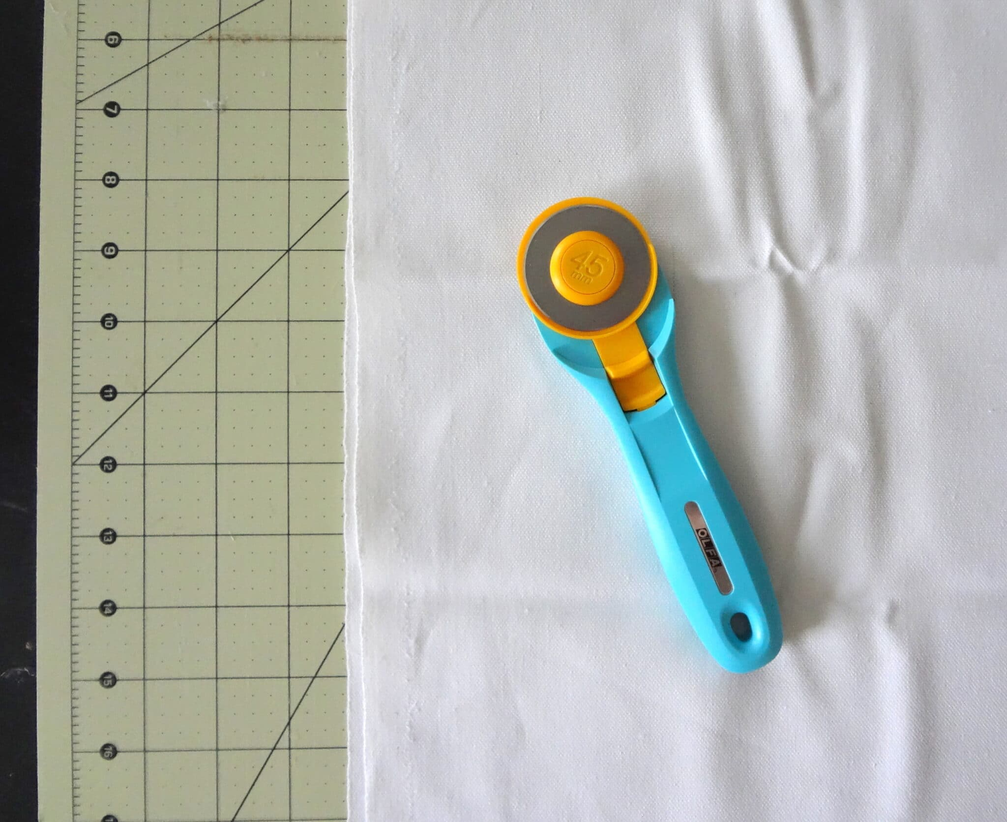 Cut fabric strips with rotary cutter