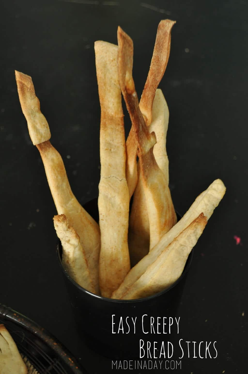 Easy Creepy Halloween Bread Sticks madeinaday.com