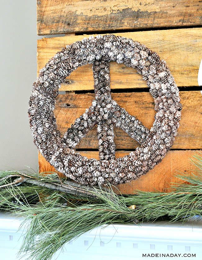 how to make a pine cone peace sign wreath