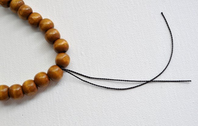 Tie a beaded necklace