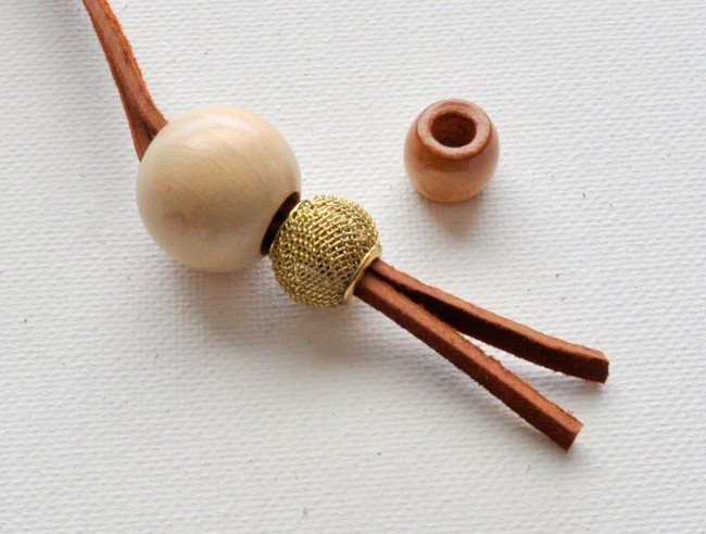 Add bead to suede string