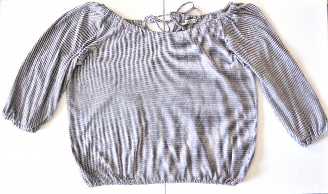 Lay your T-shirt out flat to cut