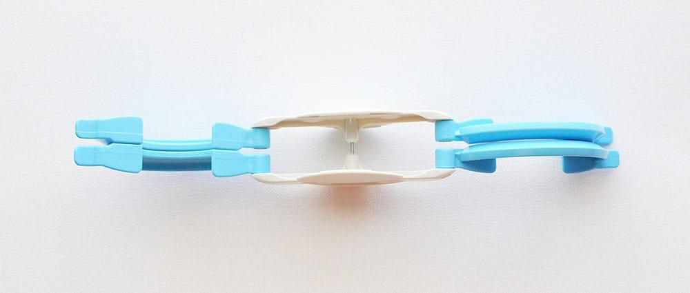 Open Pom Pom maker to wrap yarn