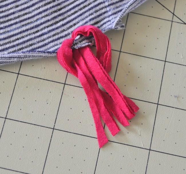 pull ends through loop on tassel