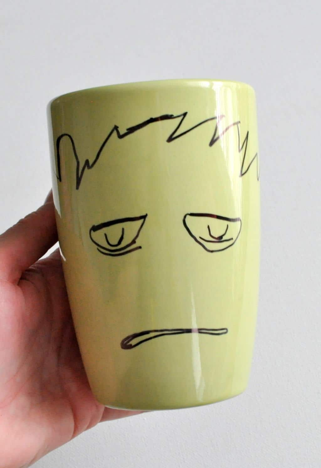 Draw a face with a Sharpie on a mug madeinaday.com