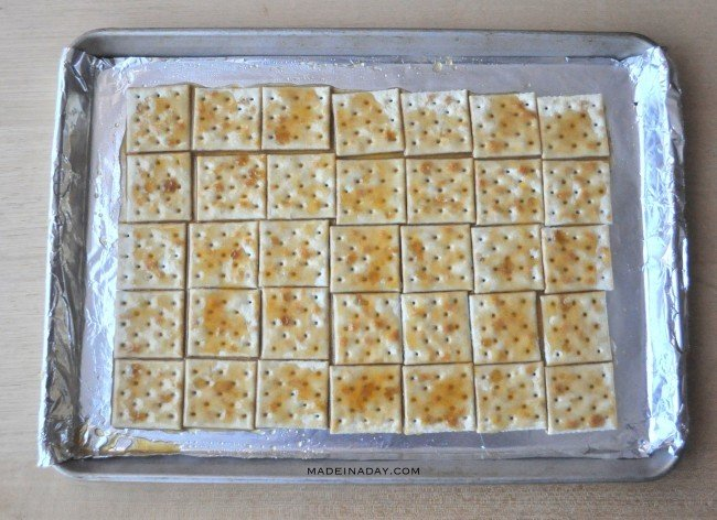 Cover Crackers with butter and brown sugar