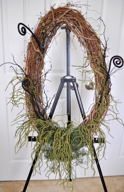 Hang wreath up to design it before securing embellishments madeinaday.com