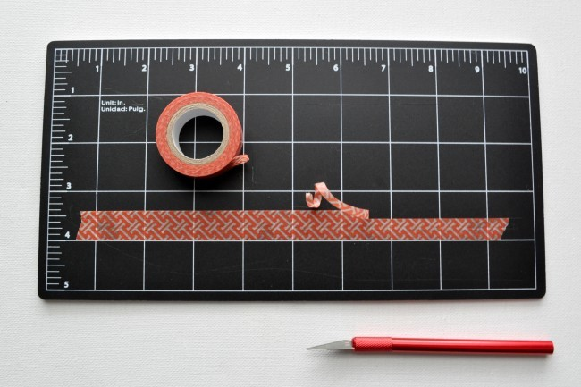 Trim washi tape with xacto knife