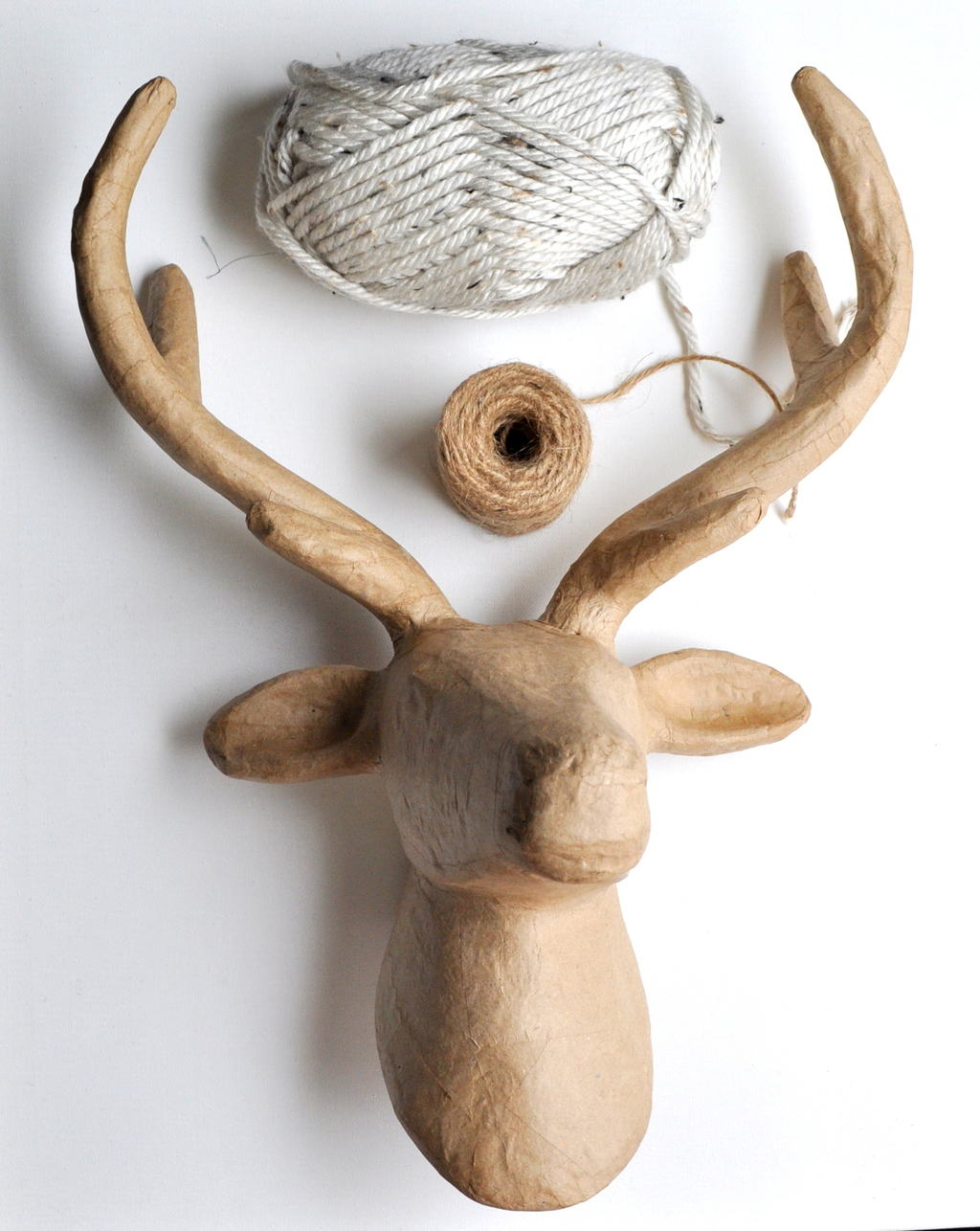 cover a faux deer head with yarn