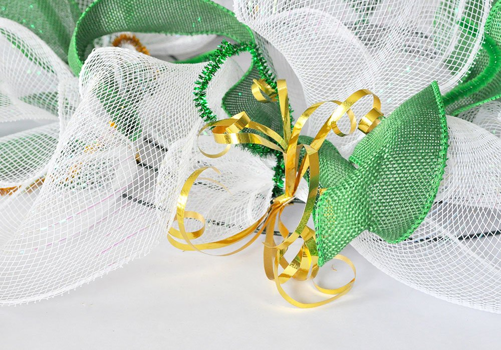 Gold ribbon added to deco mesh wreath