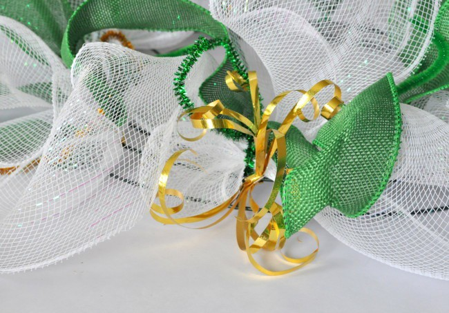 gold ribbon on deco mesh wreath