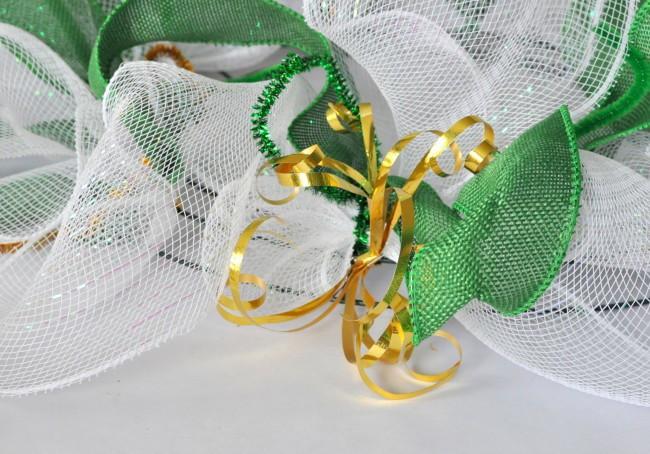 gold ribbon on deco mesh wreath