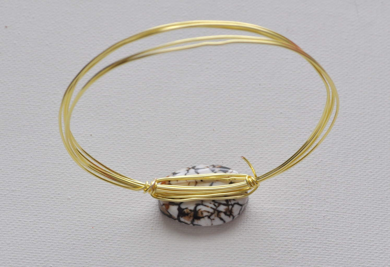 Gold, Silver and Diamond Bangle Bracelets. Bangle bracelets are all the rage. Slip-on a stack of bangles and update your look with one, two, three, or even ten bangles.