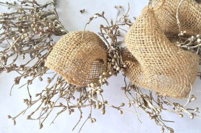Add ribbon to berry wreath like mesh