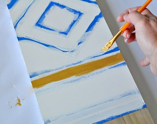 Paint geometric shapes with painters tape