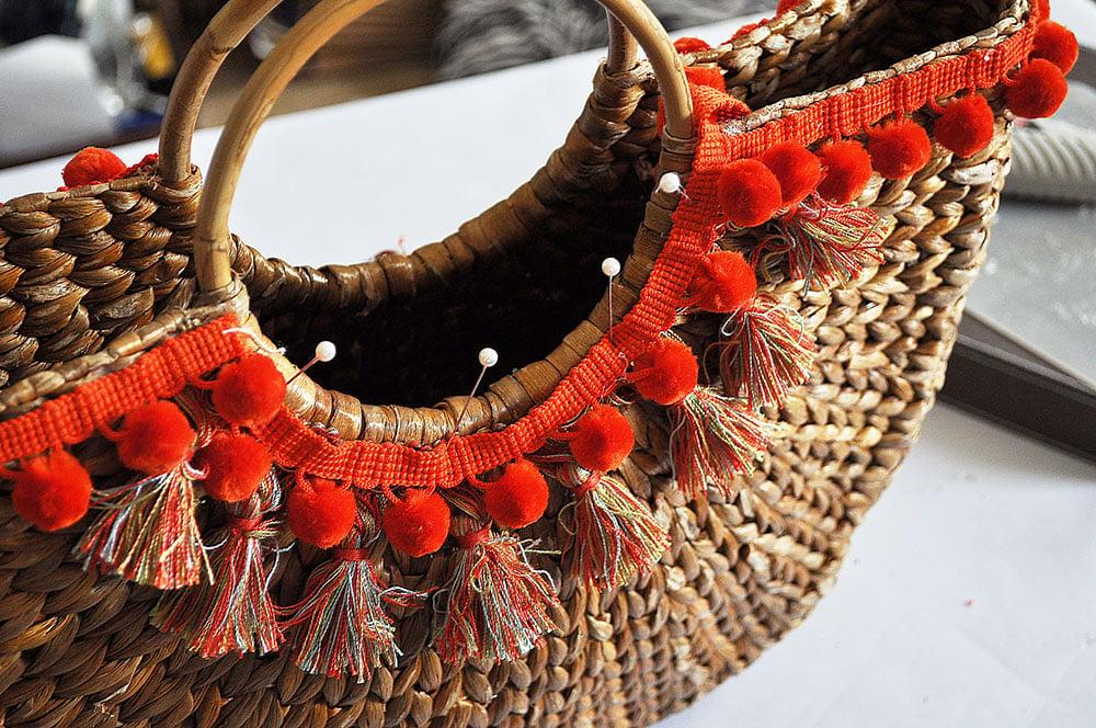 how to make a beach bag tote, pom pom basket bag, half moon straw tote makeover