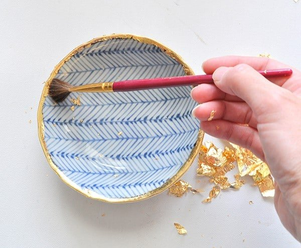 Remove excess gold gilding with a soft natural bristle brusch