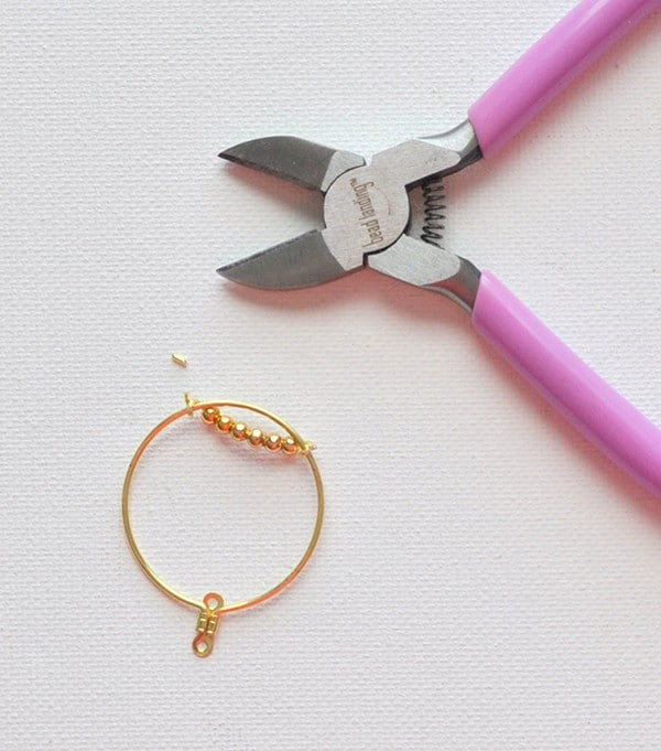 Add beads to hoop earrings