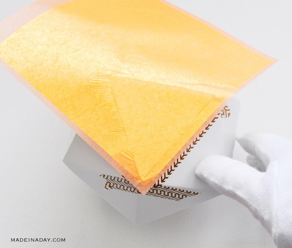 lay gold leaf sheet on pumpkin