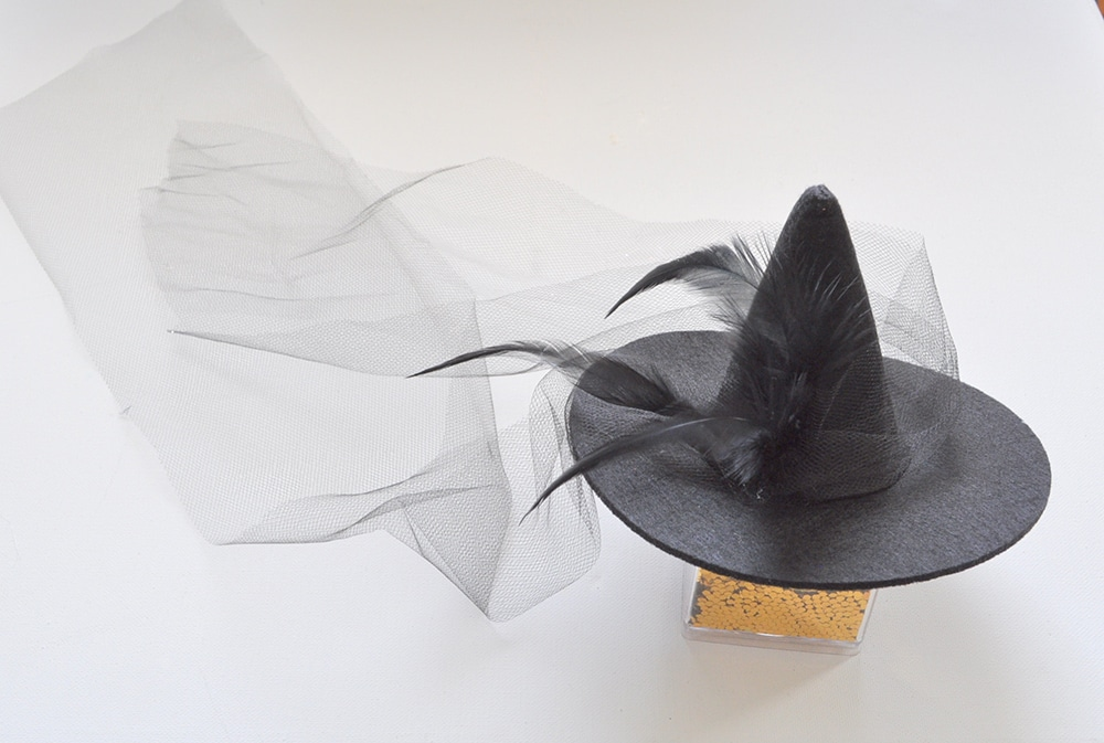 add feathers and tulle to witch hat