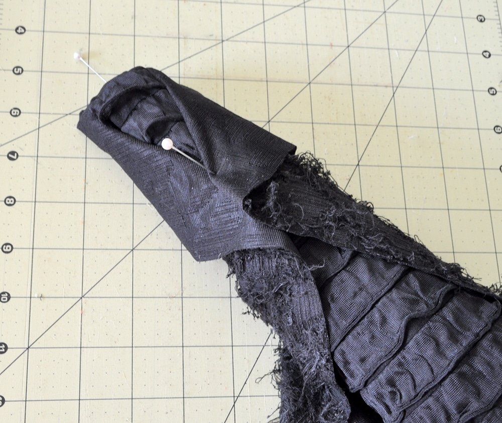 wrap fabric around top of cone like a coat