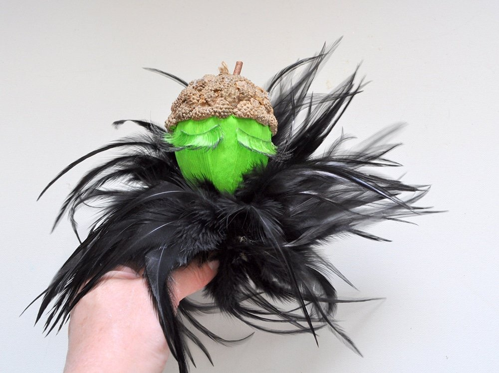 Add feather boa to witch head