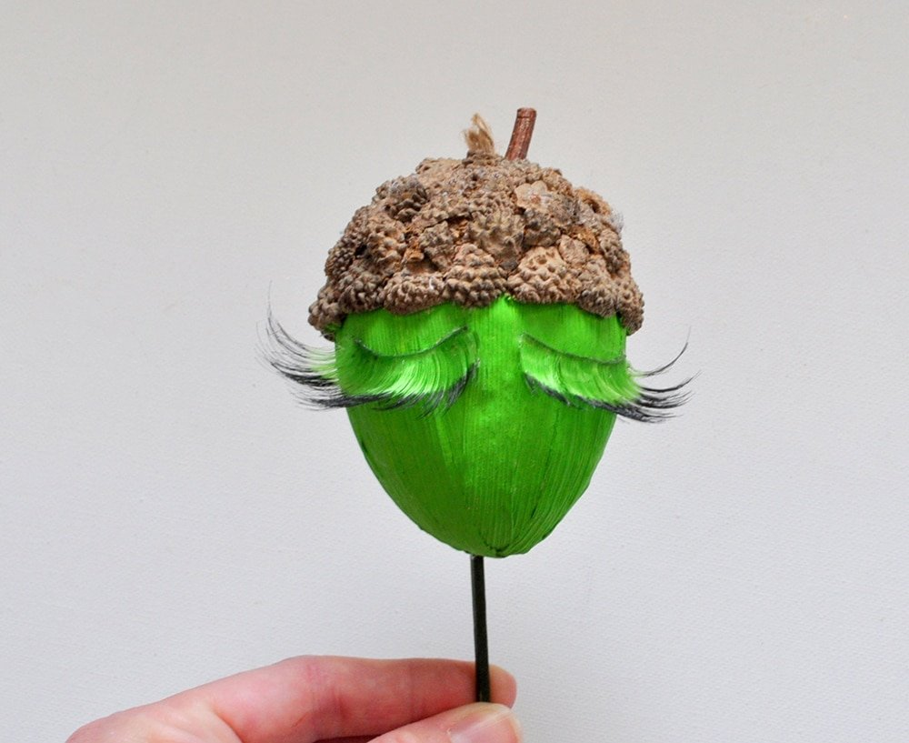 Painted acorn with lashes