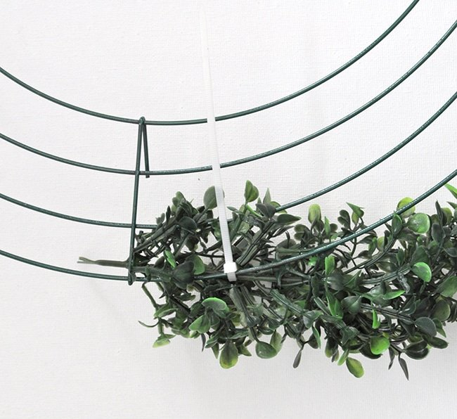 zip tie a boxwood garland to make a wreath