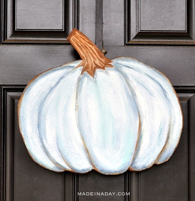 blue painted pumpkin door hanger