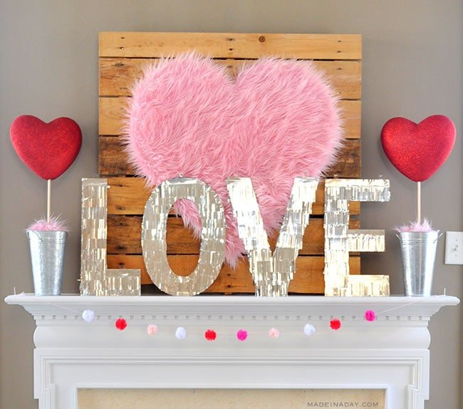 Valentine Mantle, Fur Heart, fur topiary, centerpiece, conversation heart garland, famous couples, galvanized bucket topiary, heart topiary, Valentine topiary #sponsored