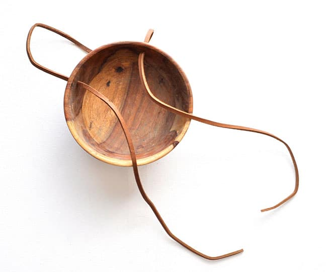 leather and wood bowl planter,