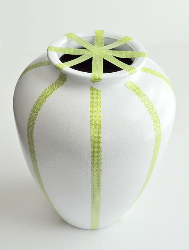tape off a vase to paint it