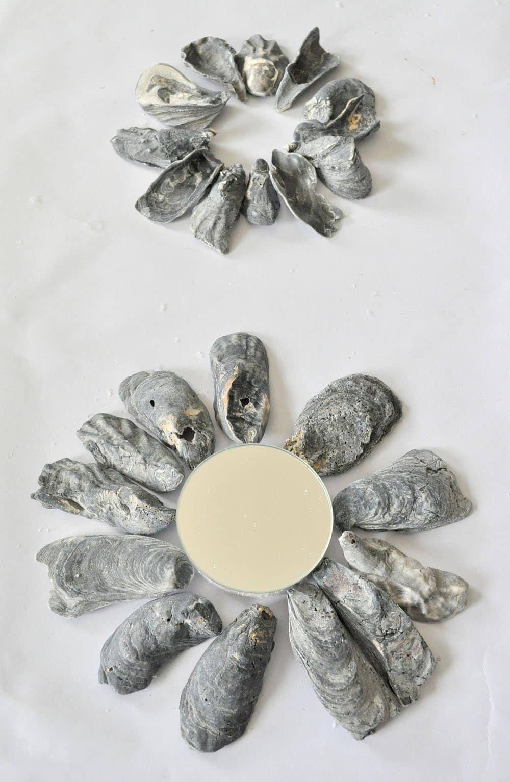arranging shells for a mirror, coastal mirror