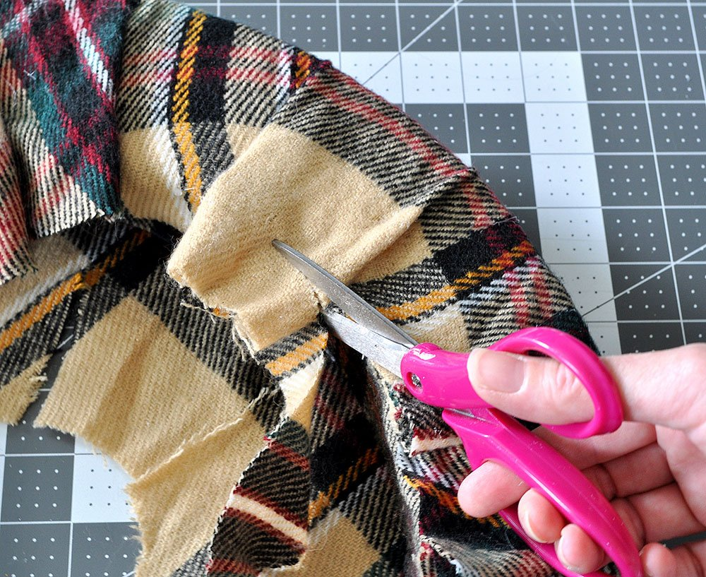 trim extra fabric from wreath